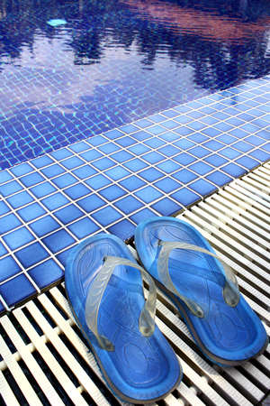 Flip Flop on poolside Stock Photo