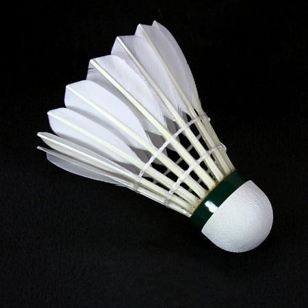shuttlecock: a white shuttlecock isolated on black