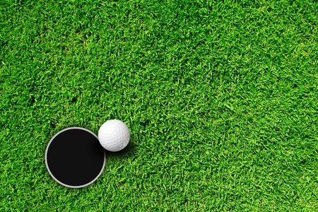 golf hole: Golf Ball on Edge of Hole  Stock Photo