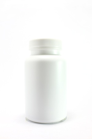 white pill bottle on white background  photo