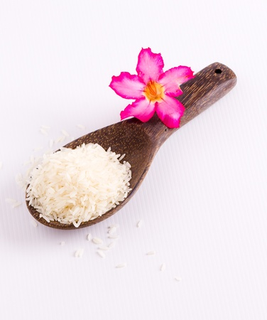 wooden spoon: uncooked rice in wooden spoon  Stock Photo
