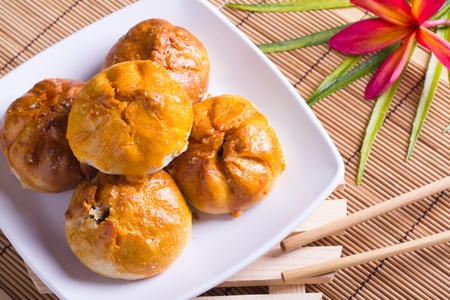 flaky: Famous Malaysian food - Seremban Siew pau. It is a type of baked bun with flaky pastry bun and meat (usually pork) filling.