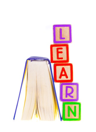 Learn Spelled Out Leaning on Open Book Stock Photo - 13707731