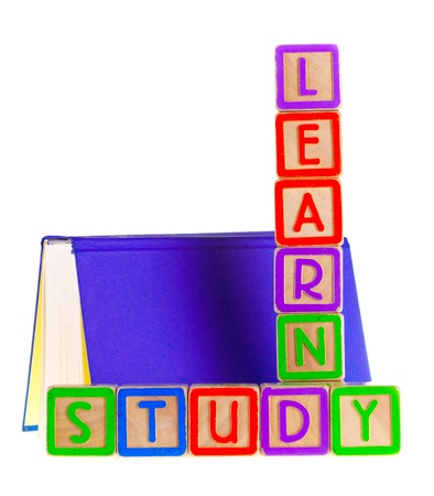 Learn Spelled Out Leaning on Open Book photo