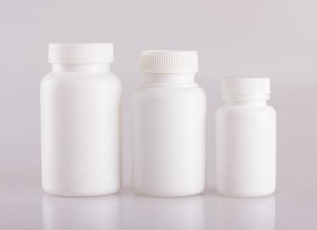 white pill bottle on white background