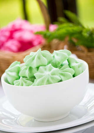 Meringue cookies of different colors photo