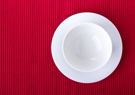 Empty bowl isolated on red background Stock Photo - 21567683