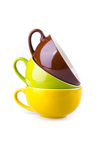 colorful ceramic cup on white background photo