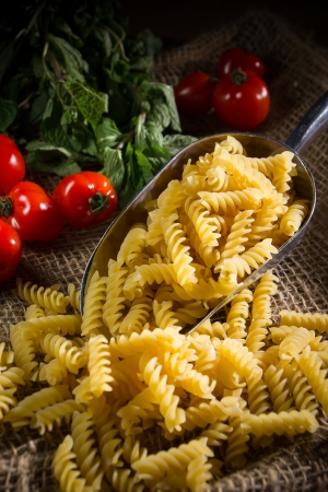 raw pasta on complex background photo