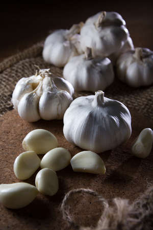 fresh garlic on wooden table photo