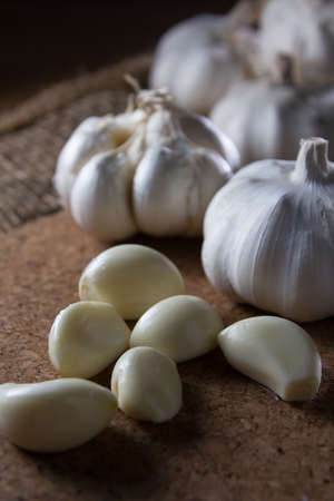 fresh garlic on wooden table photo