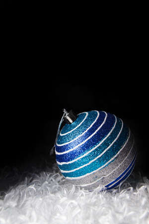 Blue christmas balls white fur background  photo