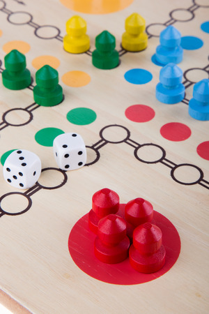 horseplay: Colored board game figures with dice