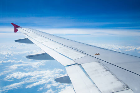 aircraft engine: Aeroplane wings in the blue sky Stock Photo