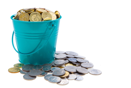 a full bucket of coins on white  photo