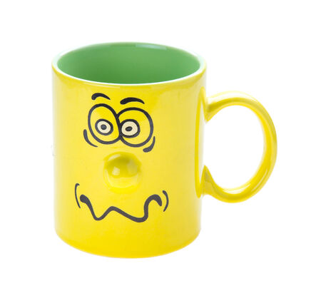 Coffee cup with a grin isolated on white background photo