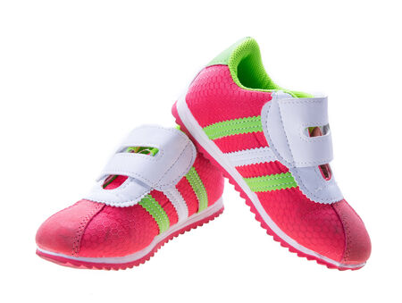 modern pinky sport shoes on white background photo