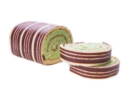 Swiss roll cake isolated on white background photo