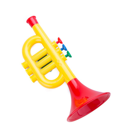 Trumpet toy for kids isolated on white background photo