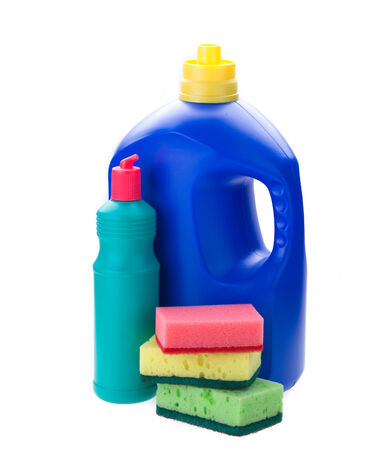 detergent bottles and sponges isolated on white background photo