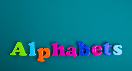 magnetic: Colorful Alphabet magnetic letters on green background