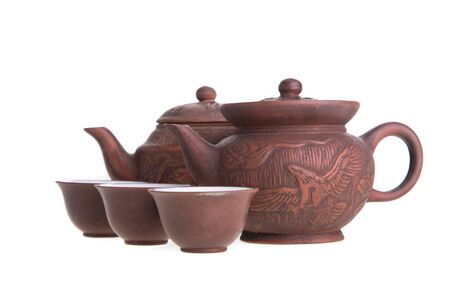 chinese teapot: Chinese teapot and teacups set isolated on white Stock Photo