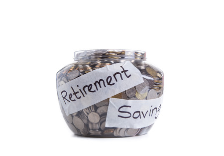 Retirement savings money in jar 免版税图像