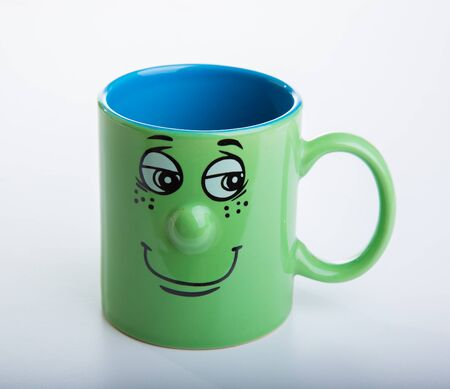 Coffee cup with a grin on white background