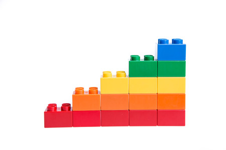 yellow lego block: Plastic building blocks isolated on white background