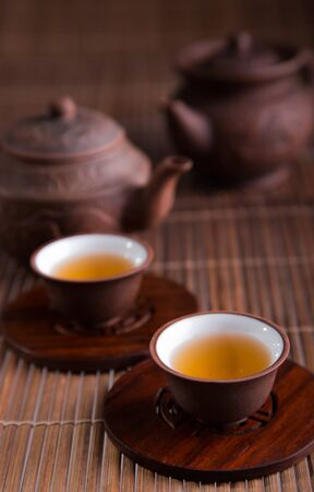 teacup: Chinese teapot and teacups set isolated on white Stock Photo
