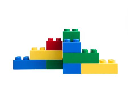 yellow lego block: Plastic building blocks isolated on white background