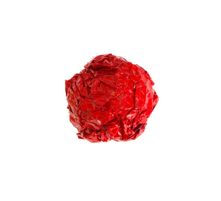useless: crumpled color paper ball isolated on white background
