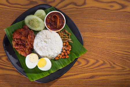 singapore culture: nasi lemak, a traditional malay curry paste rice dish served on a banana leaf