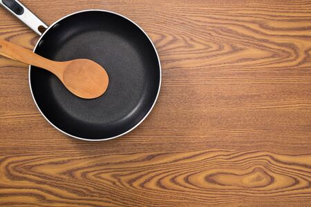 non stick: non stick frying pans on wooden background Stock Photo