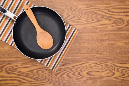 non: non stick frying pans on wooden background Stock Photo