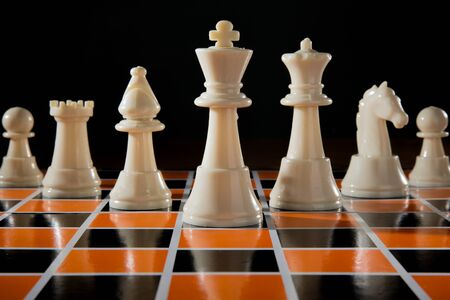 chessman: chess piece on the board background
