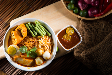 mee: Curry Laksa which is a popular traditional spicy noodle soup from the culture in Malaysia. Stock Photo