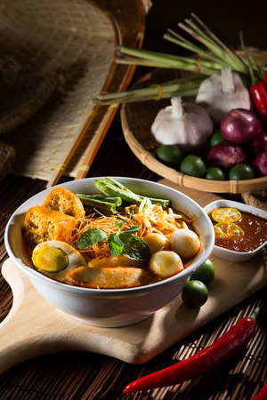 Curry Laksa which is a popular traditional spicy noodle soup from the culture in Malaysia. Stock Photo