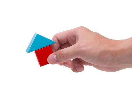 Hand and house block isolated on white background