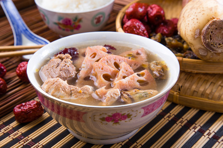 Chinese traditional lotus root soup with pork meat and red dates