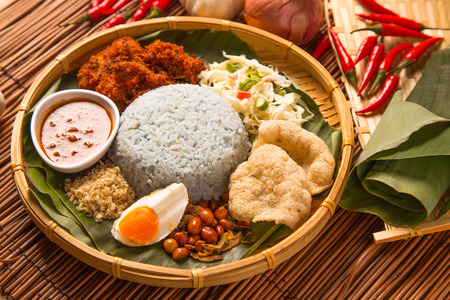 Nasi kerabu, popular Malay rice dish. Blue color of rice resulting from the petals of butterfly-pea flowers. Traditional Malaysian food, Asian cuisine.