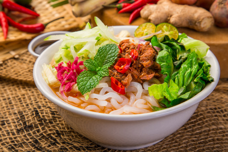 Assam Laksa (Noddle in Tangy Fish Gravy) is a Special Malaysian Food Popular in Penang Stock Photo - 85129316