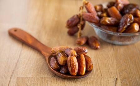 Kurma or dates on wooden background prepared for Ramadan Stock Photo
