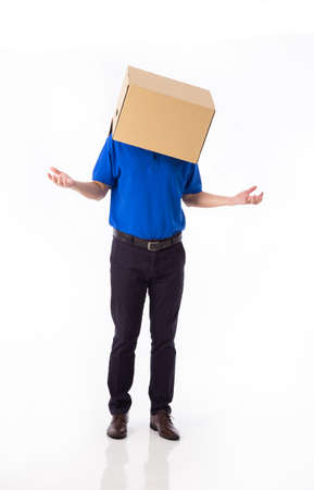 man in a bluer T-shirt with a cardboard box on his head makes a gesture with his hands isolated on white background