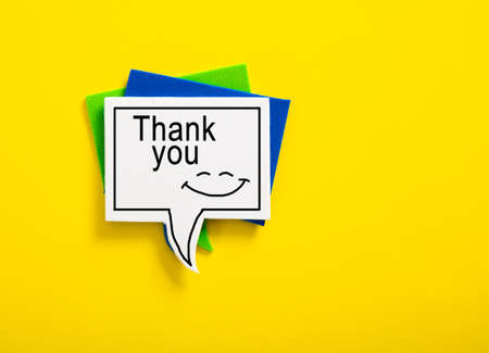 colorful speech bubble written with Thank You on yellow background