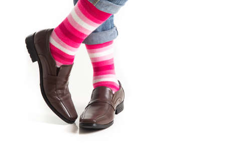Men's feet in stylish shoes and funny socks isolated on white background