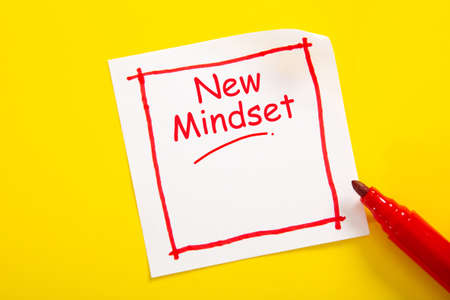 New Mindset word concept on sticky note against yellow background