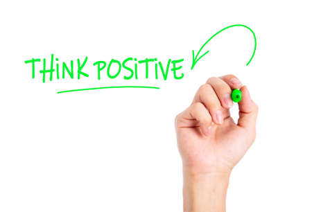 Doctor hand writing Think Positive word on a transparent wipe board.