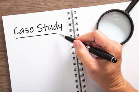 Hand writing a word Case Study on a notebook. Case Study Concept