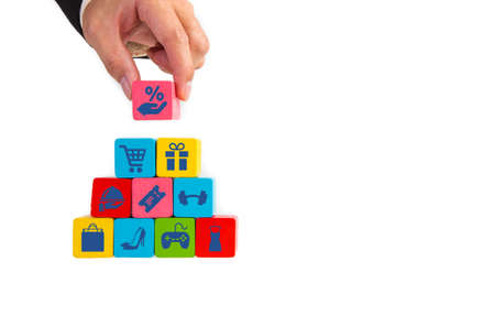 Businessman hand take wooden cube with shopping sales icon. Shopping concept.
